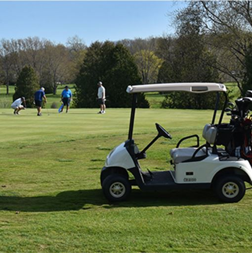 Golf Cart with People in the Background